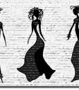 Tapeta sylwetki kobiet na tle cegieł