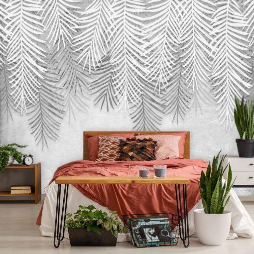 Palmowe liście na szarej fototapecie di sypialni